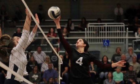 Junior Cali Nims hits the ball in the 2018 regional semifinals vs Boerne Champion at the San Antonio's South San Athletic Center.
